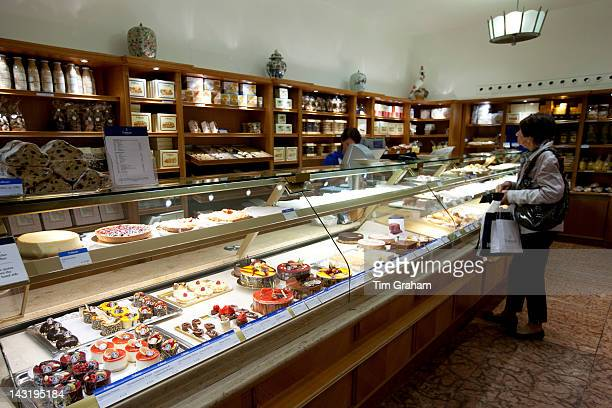 Shop display of artisan pastries and cakes at Dalmayr food shop and delicatessen in Munich Bavaria Germany