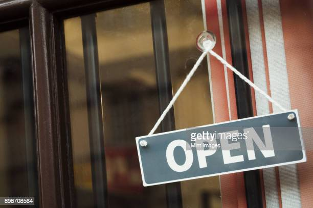 a shop door with a sign saying open. - open for business stock pictures, royalty-free photos & images