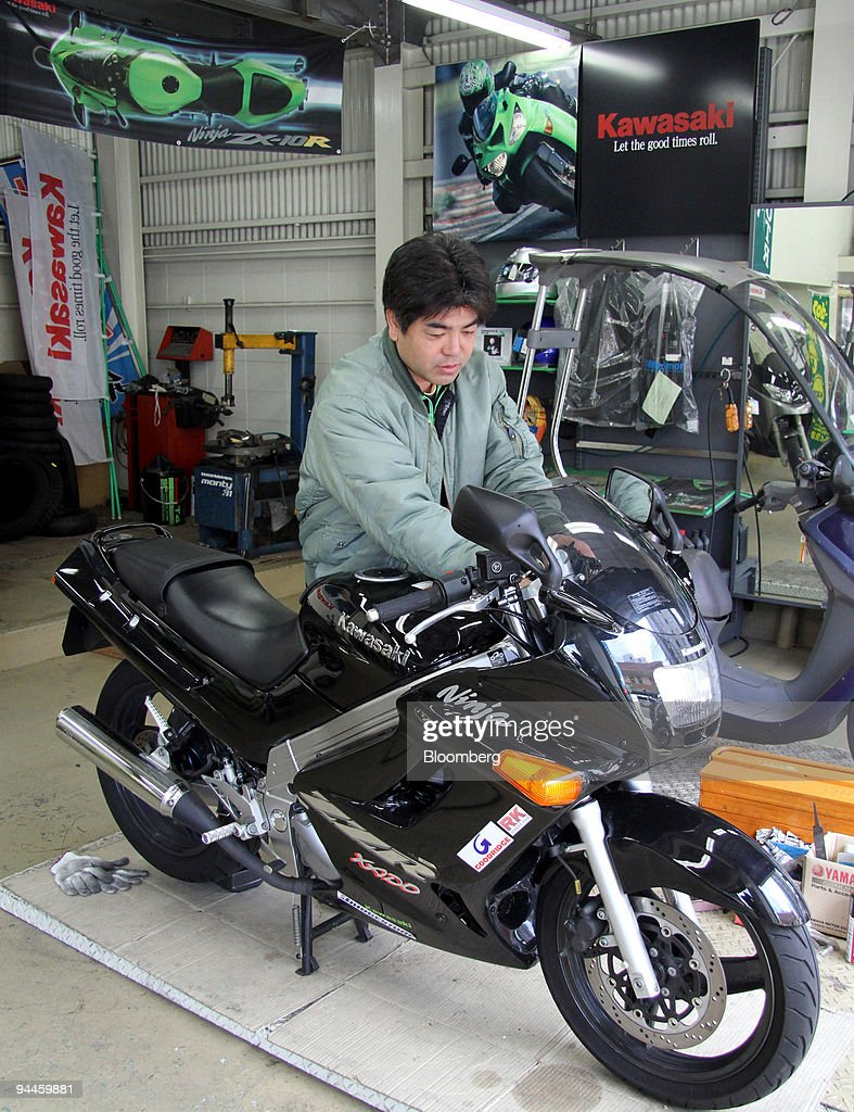 A shop employee checks a Kawasaki Heavy Industries Ltd. motorcycle at a dealership in Tokyo, Japan, on Saturday, Dec. 12, 2009. Kawasaki Heavy Industries Ltd., a Japanese maker of motorcycles and trains, aims to break even in its consumer products business next fiscal year by cutting costs, Senior Vice President Hiroshi Takata said. Photographer: Haruyoshi Yamaguchi/Bloomberg via Getty Images