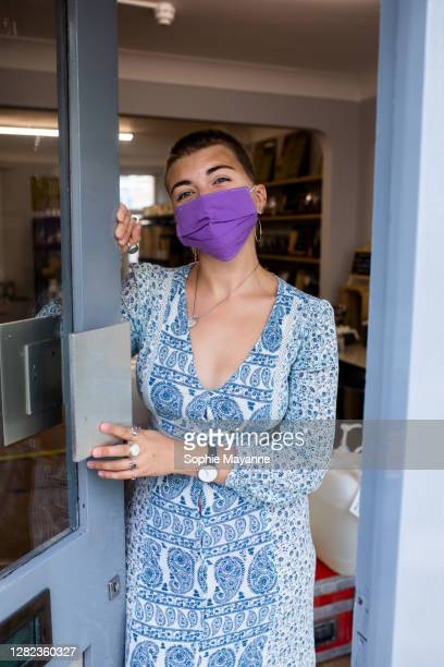 a shop employee opening the door to her shop - open stock pictures, royalty-free photos & images