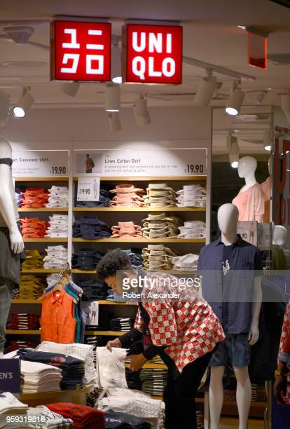A shop employee prepares a clothing display at a Uniqlo store in Union Station in Washington DC
