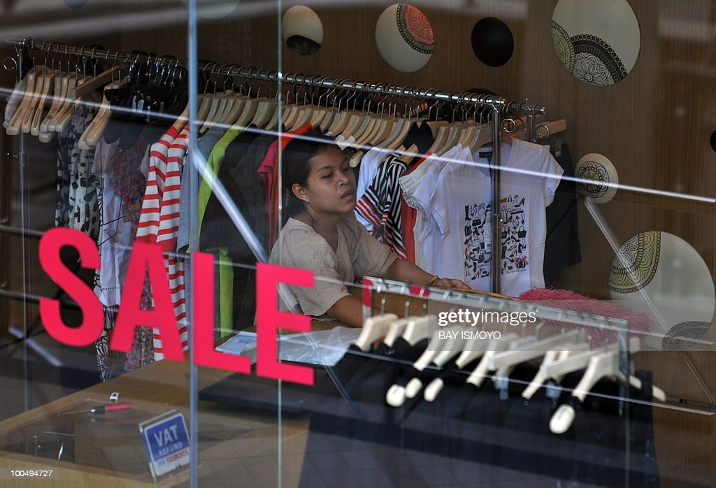 A shop employee prepares for business in downtown Bangkok on May 25, 2010. Thailand's economy grew at breakneck pace early this year but the deadly unrest that began in March will clip the full-year performance by 1.5 percentage points, officials said. AFP PHOTO / Bay ISMOYO