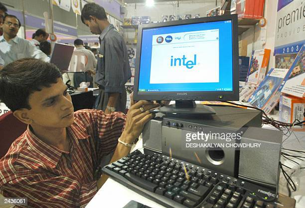 Shop employee sets up an LCD monitor at the Computex-2003 IT Fair in Calcutta, 22 August 2003. About a hundred computer harware, software dealer take...