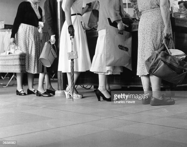 Shop floor view of women shopping at one of Marks and Spencer's 234 stores. Original Publication: Picture Post - 7984 - Quality, Value and Good...