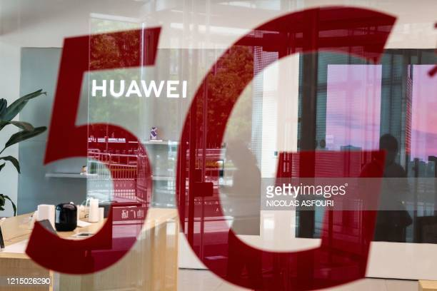 "Shop for Chinese telecom giant Huawei features a red sticker reading ""5G"" in Beijing on May 25, 2020."