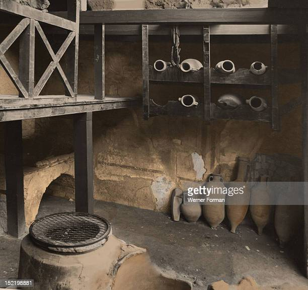 Shop for wine and cereals attached to the 'House of the Neptune Mosaic', View of the storage room with the wine amphoras. Italy. Roman. Herculaneum.