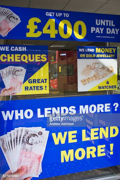 A shop found in Dalston London UK that deals in loans debts and gold The advertisement pasted onto the window pictures lots of cash and has written...
