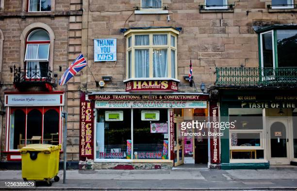 shop front in matlock bath - bavosi stock pictures, royalty-free photos & images