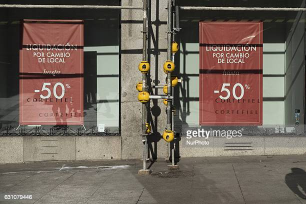 A shop front sign announces discounts on the first day of the winter sales in Madrid on January 6 2017 The period of winter sales in Spain is from...