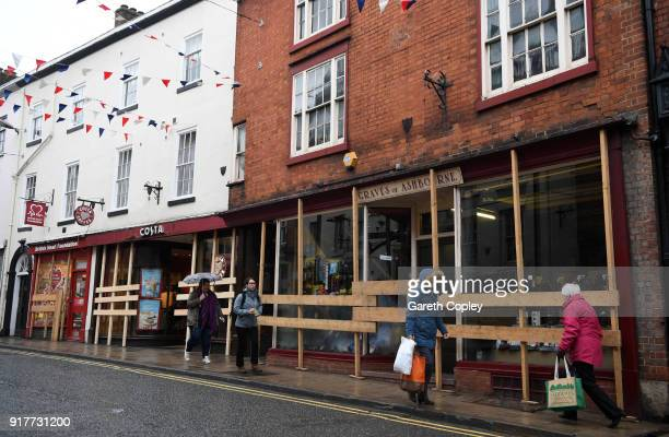 Shop fronts board their windows in preparation for the start of the Shrovtide Football match where rival teams 'Up'ards' and 'Down'ards' battle for...