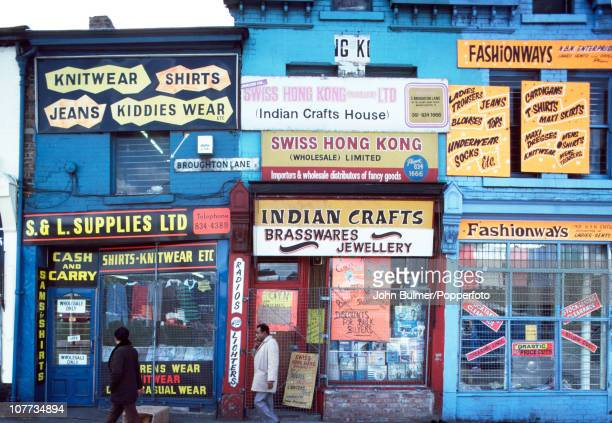 Shop fronts in Manchester England including an Indian crafts shop 1976