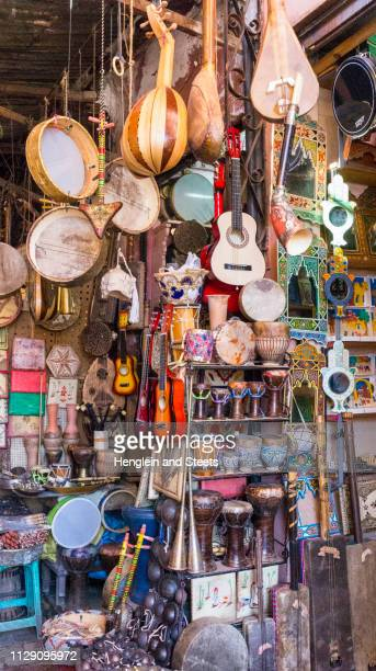shop full of traditional musical instruments, marrakech, morocco - tambourine stock photos and pictures