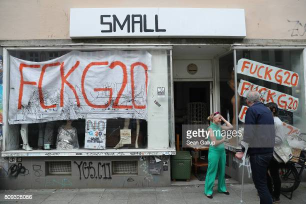 A shop in the city center stands covered in antiG20 logos ahead of Friday and Saturday's G20 summit on July 5 2017 in Hamburg Germany Authorities are...