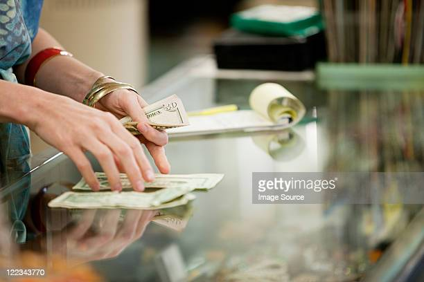 shop keeper counting money in shop - counting stock pictures, royalty-free photos & images