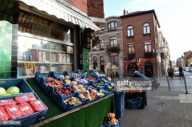 A shop keeper sets up his wares accross the bar Les Beguines owned by Brahim Abdeslam one of the suicide bombers implicated in the Paris attacks on...