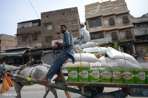Shop keepers buy sacks of flour fearing a shortage due to the corona virus outbreak in Peshawar Pakistan