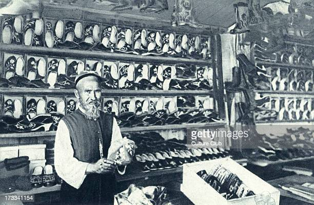 Shop of bootmaker in Kazan, 20th century. Capital and largest city of the Republic of Tatarstan, Russia.
