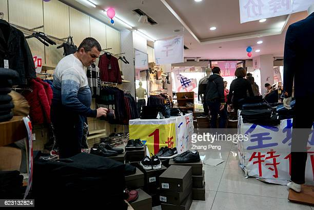 A shop offers great discount to attract customers mostly of whom are Russian Hunchun is a city bordered with Russia Everyday many Russian people come...