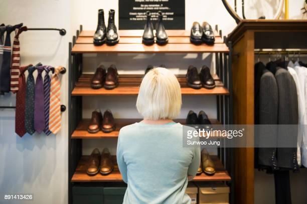 Shop owner browsing products in men's boutique