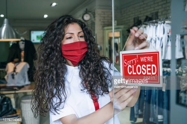 shop owner closed down due to coronavirus second wave.sorry we`re closed again - closing stock pictures, royalty-free photos & images