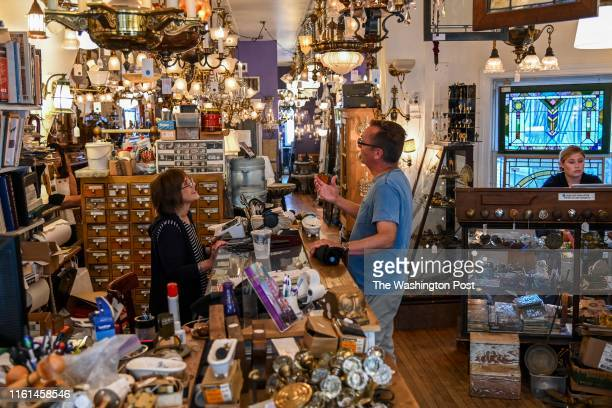 Shop owner Donetta George L assists Jeffrey Feltman at The Brass Knob Architectural Antiques on Wednesday July 31 in Washington DC The shop which...