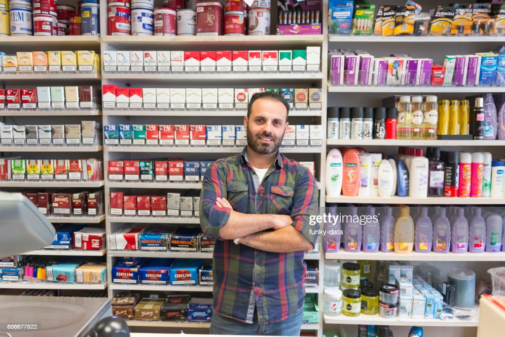 Shop owner from minority group : Stock Photo