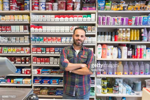 shop owner from minority group - kiosk stock pictures, royalty-free photos & images