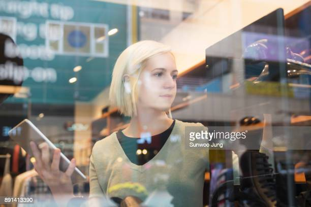 Shop owner holding tablet checking up products in store