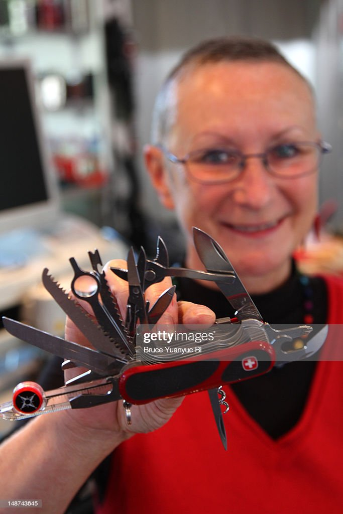 shop owner holding the wenger giant swiss army knife v10 the worlds