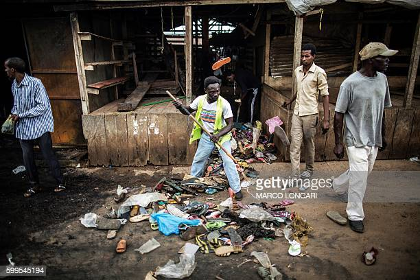 A shop owner is seen in front of his looted and burned shop in Bitam in the north of Gabon near the border with Cameroon on September 5 2016 On...