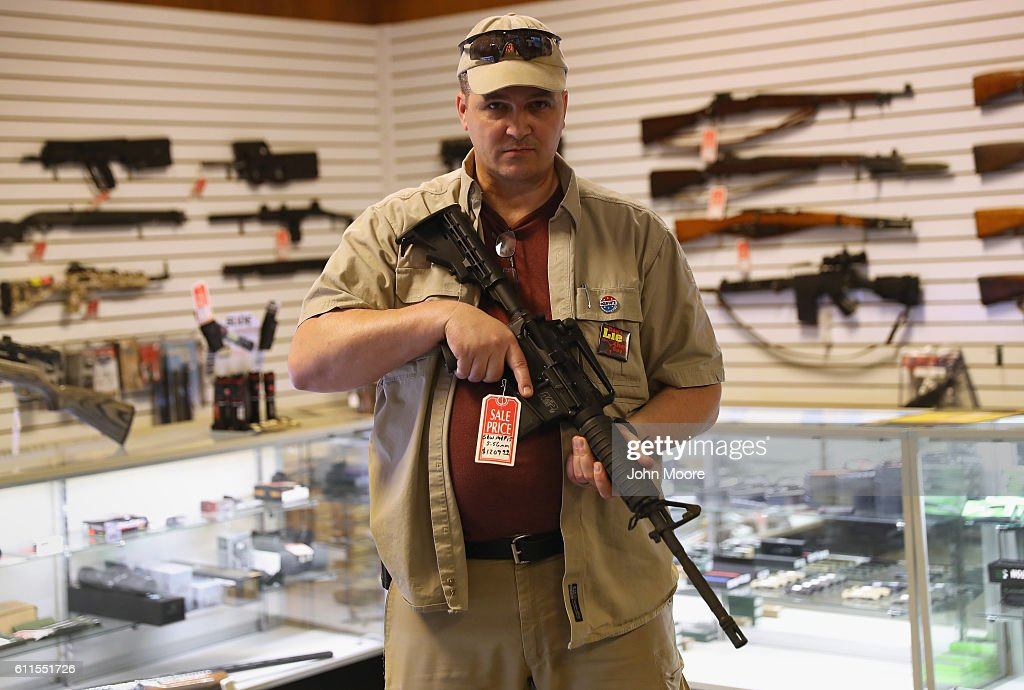 Shop owner Jeff Binkley displays an AR-15 'Sport' rifle at Sarge's Sidearms on September 29, 2016 near Benson, Arizona. He said he redesigned and renamed his store just this year. Gun shops are proliferate in Arizona, which regulates and restricts weapons less than anywhere in the United States.