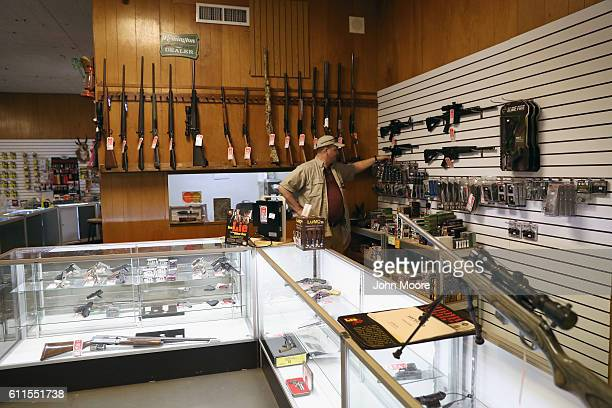 """Shop owner Jeff Binkley displays AR-15 """"Sport"""" rifles at Sarge's Sidearms on September 29, 2016 near Benson, Arizona. He said he redesigned and..."""