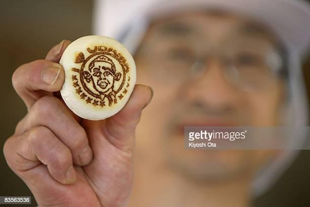Shop owner Koichi Inoue displays 'Obama manju' in support of the Democratic presidential candidate US Sen Barack Obama at Japanese traditional sweet...