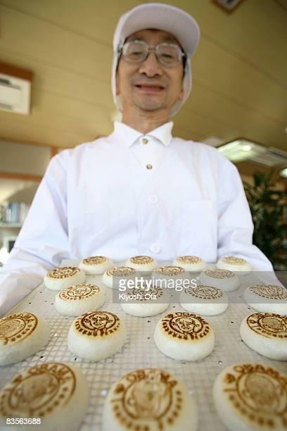 Shop owner Koichi Inoue displays Obama manju in support of the Democratic presidential candidate US Sen Barack Obama at Japanese traditional sweet...