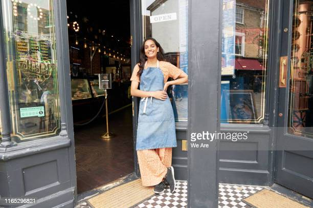 shop owner outside her ice cream parlor - one woman only stock pictures, royalty-free photos & images