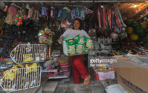 A shop owner prepares for business at Sikakap village in South Pagai in the Metawai islands west of Sumatra island on November 2 a week after a...