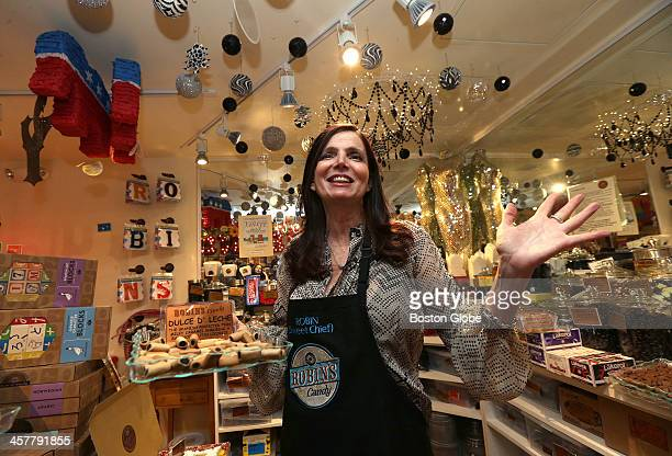 Shop owner Robin Helfand prepares to hand out samples during a Licorice tasting at Robin's Candy on Newbury Street