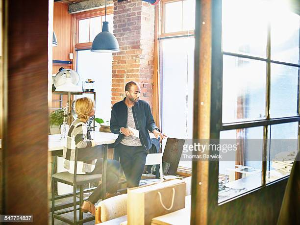 Shop owners in discussion in office of boutique