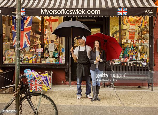 Shop owners Jennifer Myers and Roger Clark are photographed for Vanity Fair Magazine on March 10 2015 in front of their grocery store Myers of...