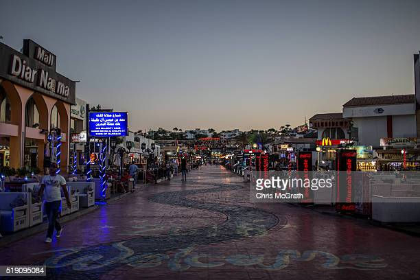 Shop owners wait for customers along a tourist street in Naama Bay on April 1 2016 in Sharm El Sheikh Egypt Prior to the Arab Spring in 2011 some...