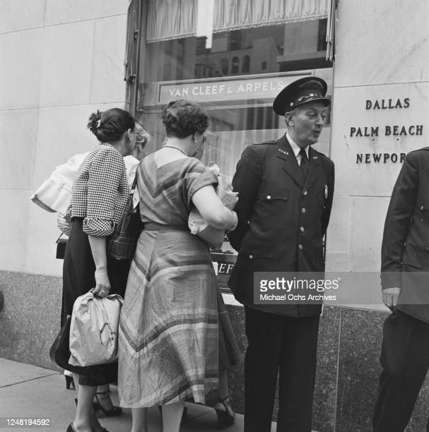 Shop security guard outside the Van Cleef & Arpels jewellery store on Fifth Avenue, New York City, circa 1952.