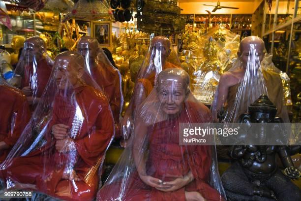 A shop selling Buddhist memorabilia in Bangkok city center On Friday June 08 in Bangkok Thailand