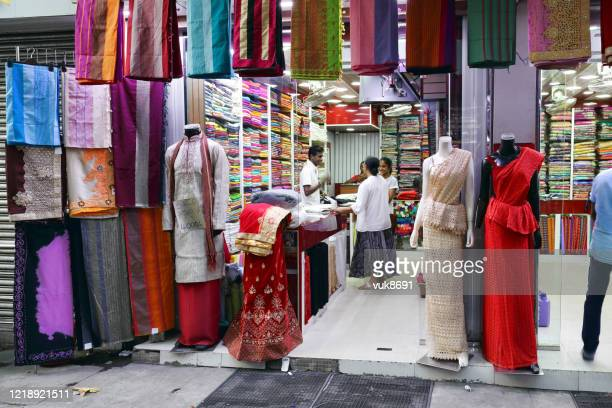 shop selling dresses and saris in the street - sari stock pictures, royalty-free photos & images