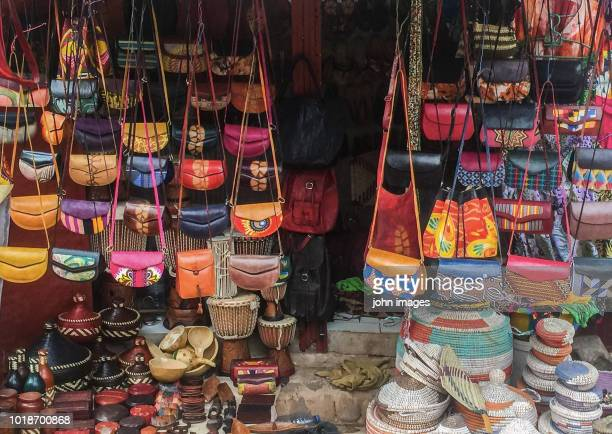 a shop selling leather bags and pot - dakar senegal stock pictures, royalty-free photos & images