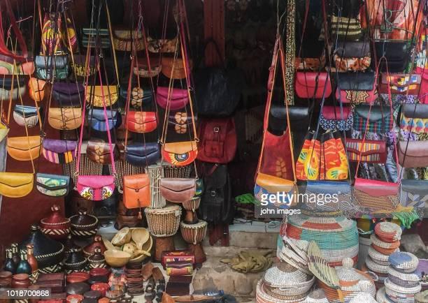 a shop selling leather bags and pot - dakar senegal stockfoto's en -beelden
