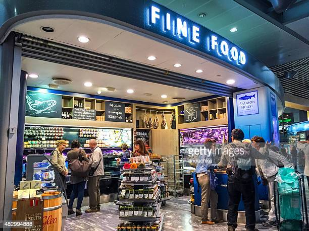 shop selling norwegian local famous food at oslo airport - convenience store interior stock photos and pictures