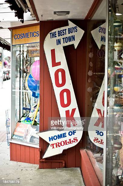 Shop signage outside of a tourist gift shop in Lake George, NY. Arrow entices customers with the promise of 'The best buys in town' as well as being...
