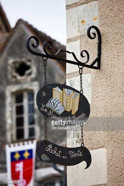 Shop signs in traditional French village of Angles Sur L'Anglin Vienne near Poitiers France