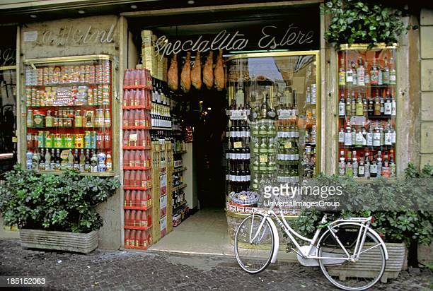 Shop vendor Campo dei Fiori market Rome Italy with white bicycle