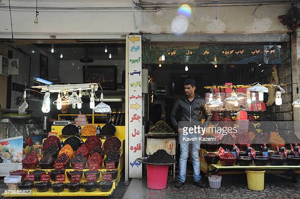 Shop vendor stands outside a shop selling dried fruits in Darband April 21, 2013 in Tehran, Iran. Darband is located on the foothills of Tehran and...